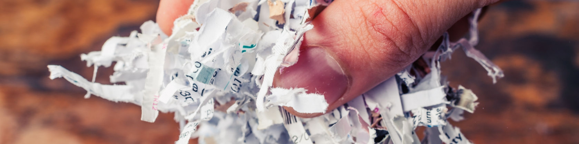 Hand is holding a bunch of shredded paper